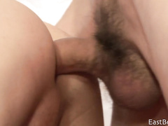Curly twink erects big dick and gets hotly fucked
