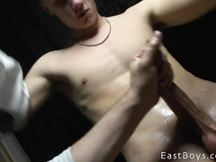 Sexy blonde guy excitingly poses and enjoys handjob