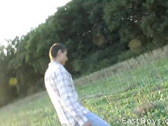 Slender sexy twink is getting his dick stroked at the field