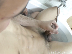 Charming sexy shaped twink enjoys handjob in bathtub