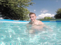 Twink friends are teasing each other in the pool