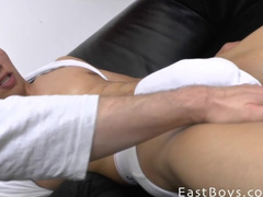 Latina guy with gay haircut is sitting on couch and being fondled