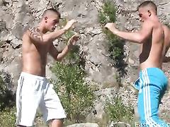 Sporty shaped slender gay friends are pleasuring masturbation outdoors