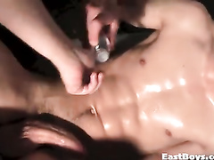 Beautiful blond twink gets handjobbed in front of the camera