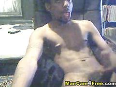 Black gay dude is pleasantly masturbating on hot gay porn
