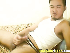 Asian twink watches exciting gay porn and jerks off cock
