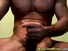 Twink with hot muscled body enjoys jerking off huge dick
