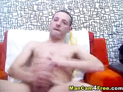 Skinny hunk is watching gay porn and jerking off his dick