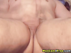 Tight muscled twink hotly masturbates his dick to the camera