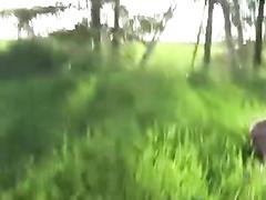 Twink pleasure handjob outdoors on green grass