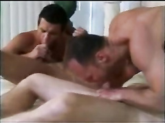 Young twink is getting fucked hard by three dirty hunks in turn